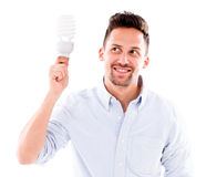 Man with an energy bulb Stock Photos