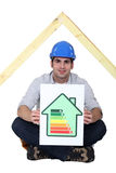 Man with energy rating. Scale royalty free stock image