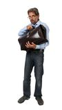 Man enfolds suitcase isolated Royalty Free Stock Photos