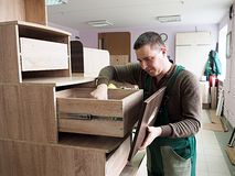Man is engaged in assembling of furniture royalty free stock photography