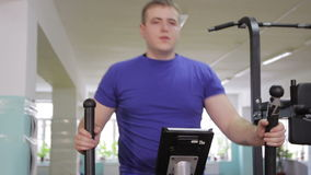 Man engaged in the gym stock video