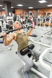 Man engaged in physical exercise in the gym Stock Photography