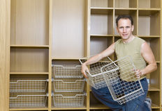 The man is engaged in repair and furniture assembl Royalty Free Stock Photography