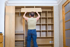 The man is engaged in repair and furniture assembl Stock Photo
