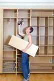 The man is engaged in repair and furniture assembl Stock Photography