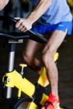 Man engaged on stationary bike Stock Photo