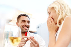 Man with engagement ring making proposal to woman Royalty Free Stock Images