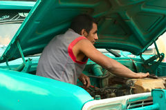 Man in Engine Bay of a Car in Silvia, Colombia Royalty Free Stock Photography