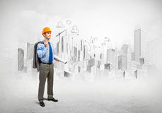 Man engineer. Image of man engineer in helmet with drafts. Construction concept Royalty Free Stock Photo