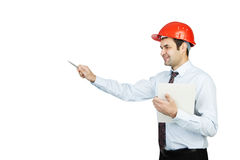 Man engineer in a red helmet shows his pen Stock Photos