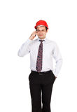 Man engineer in a red helmet talking on the phone Stock Photography