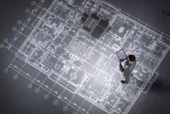 Man engineer thinking over his plan. Mixed media stock illustration