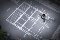 Man engineer thinking over his plan. Mixed media vector illustration