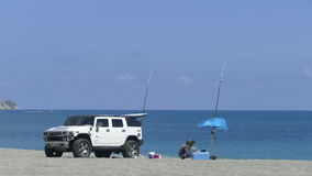 The man enjoin fishing on the beach with nice weather in New Tai Stock Images