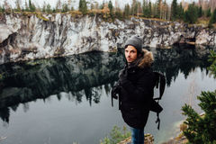 Man enjoy beautiful lake view from the hilltopl and good weather in Karelia. Around the rocks. Royalty Free Stock Photos