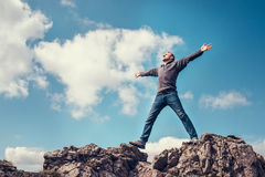 Man enjoy with freedom feel on the top of mountain stock image