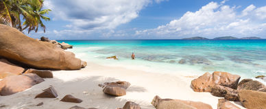 Man enjoying Anse Patates picture perfect beach on La Digue Island, Seychelles. Stock Images