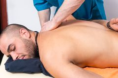 Man enjoying a back massage in a clinic Stock Image