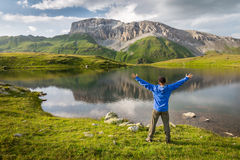 Man enjoying beautiful summer mountain landscape during his hiking trip Royalty Free Stock Photos