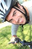 Man enjoying a bike ride Stock Photos