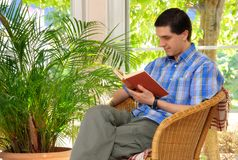 Man enjoying a book at home Royalty Free Stock Image