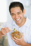 Man Enjoying Chinese Food With Chopsticks Stock Photos