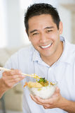 Man Enjoying Chinese Food With Chopsticks Royalty Free Stock Images