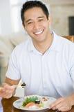 Man Enjoying Chinese Food With Chopsticks Stock Image