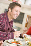 Man Enjoying Christmas Dinner Stock Photography