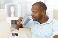 Man enjoying coffee at home Stock Photography