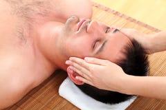 Man enjoying face massage Royalty Free Stock Image