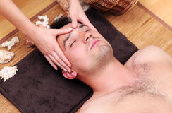 Man enjoying face massage Stock Photo