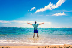Man enjoying freedom  in water on the beach Stock Photos