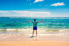 Man enjoying freedom  in water on the beach Stock Image