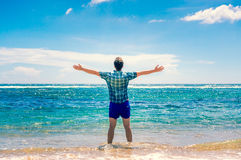 Man enjoying freedom  in water on the beach Stock Images