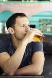Man Enjoying glass Of juice Stock Images