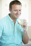Man Enjoying A Glass Of White Wine Royalty Free Stock Photography