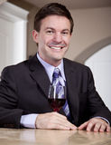 Man enjoying a Glass of Wine. A man (possibly a sommelier) judging the color and clarity of a glass of wine before enjoying it Stock Images