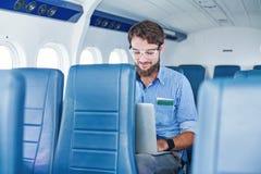 Man enjoying his journey by airplane Stock Photos