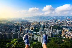 Man enjoying Hong Kong view from the Lion rock. First person view royalty free stock photography