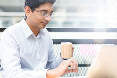 Man enjoying hot milk tea outdoor Royalty Free Stock Images
