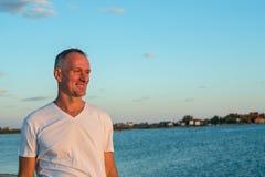 Man enjoying life on the seaside Stock Images