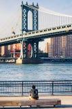 Man enjoying the Manhattan Bridge view in New York Royalty Free Stock Image