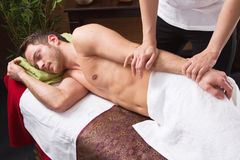 Man enjoying massage in salon Stock Image