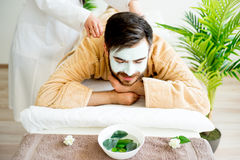 Man enjoying a massage. Session at spa Stock Photography