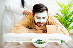 Man enjoying a massage. Session at spa Royalty Free Stock Image
