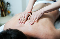 Man enjoying massage at spa. Young man enjoying massage at spa Royalty Free Stock Photo