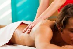 Man enjoying massage in wellness spa Stock Photography