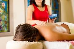 Man enjoying massage in wellness spa Stock Image