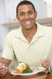 Man Enjoying A Meal At Home Royalty Free Stock Photos